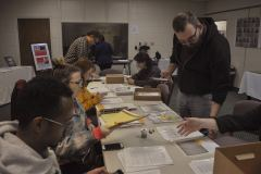 Professors and students documenting death certificates and other documents