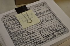 Bundle of death certificates to be photographed