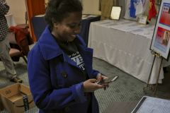 Felicia Bevel photographing documents