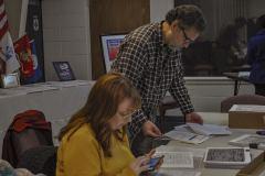 Laura Bullard and David Sheffler and student documenting archives