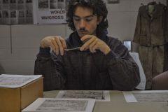 Francisco Mendoza documenting death certificates