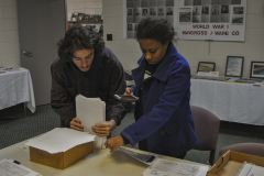 Francisco Mendoza documenting death certificates with Felicia Bevel